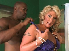 Chunky blonde reverse parks on a big black dick