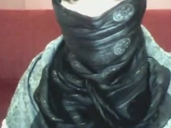 Phlegmatic arab hotty in hijab plays on her computer
