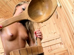 Cute babe Amanda is in the sauna and poses at the carrying-on in all directions her twat