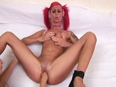 Punk redhead gets fisted and whipped by their way lesbian lover