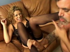 Strange blonde in stockings licks her feet and gives a footjob