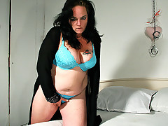 Chubby beauty is taking a dildo median her dirty mouth