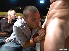 Sexy youthful guy engulfing stripper dick at party