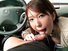 Cute Asian sucks ramrod in the car and fucks