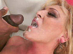 Sexy granny is getting some black dick deep inside her wet slit